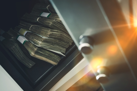 cash box: Small Residential Vault with Pile of Cash Money. Closeup Photo.