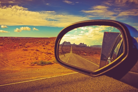 bye: Travel Trailer Road Trip in Arizona. Looking Back and Saying Good Bye to the Famous Monuments Valley. Stock Photo