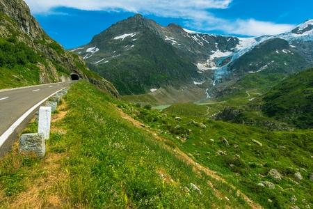 destination scenics: Summer Alpine Road. Scenic Mountain Pass Road with Tunnel. Switzerland Alps. Europe.
