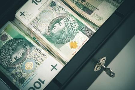 safe box: Polish Zloty Cash Money in the Cash Safe Box. Stock Photo