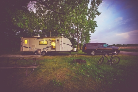 RV Camping Adventure. SUV Pulling Travel Trailer.