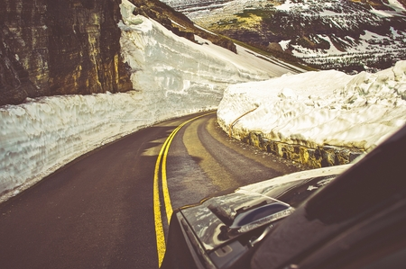 avalanche: High Avalanche Risk Mountain Road. Driving Through Mountain Pass During Spring. Stock Photo