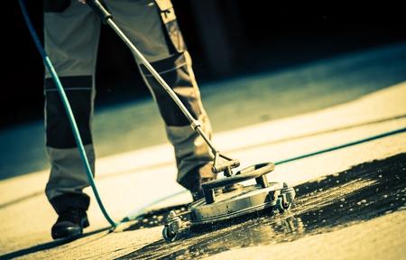 Limpieza de ladrillo El uso de System Mechanic Cepillo de limpieza con agua a alta presión de pulverización.