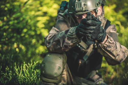 solider: Solider with Handgun. Special Forces Military Mission Concept Photo.