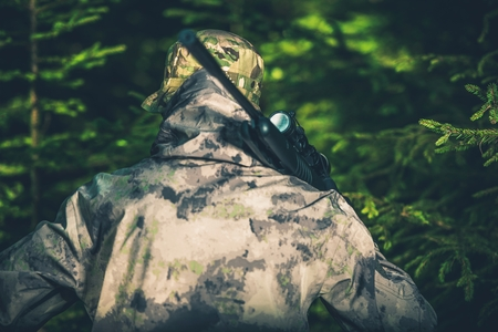 poaching: Forest Hunting For Wildlife. Illegal Poaching Activity Photo Concept. Illegal Forest Hunter.