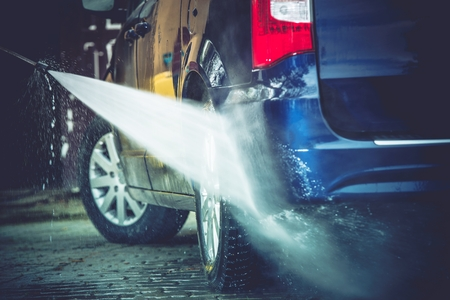 soaping: Backyard Car Washing Closeup Photo. Power Washing and Cleaning Family Van. Stock Photo