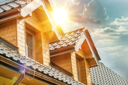 House Roof and Attic Windows Closeup. Sunny Day. Housing and Construction Concept Photo. Imagens - 56892252