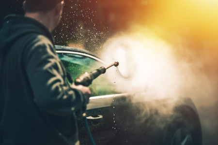 soaping: Powerful High Water Pressure Car Washing at Home. Car Cleaning. Stock Photo