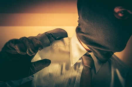 felony: Bankster in a Mask. Felony Financial Worker Concept. Gangster Banker. Stock Photo