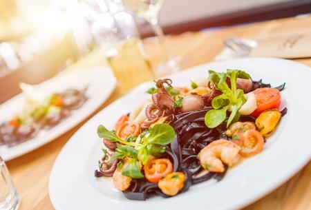 Italian Food Serving. Black Pasta with Sea Food. Italian Food.