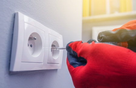 electric power: Electric Works. Power Outlet Installing. European Power Outlet System. Stock Photo
