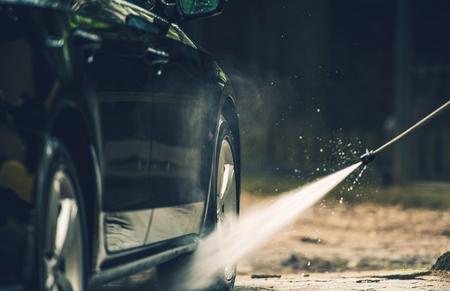 soaping: Detailed Car Washing Using Pressured Water Spraying.