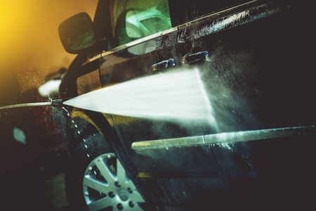 soaping: Car Cleaning by High Pressure Water Cleaner.  Closeup Photo. Car Washing.