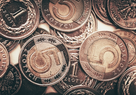 zloty: Polish Currency Coins. Five and One Zloty Coins Closeup Photo.