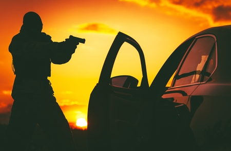 counter terrorism: Counter Terrorism Check Point. Hunt For Terrorists. SWAT member in a Mask Pointing His Gun on Terrorist Member Inside Stopped Vehicle. Stock Photo