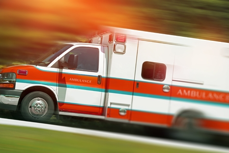 Ambulance Emergency Call. Speeding Ambulance Vehicle. Paramedics in Action. Reklamní fotografie - 56892350