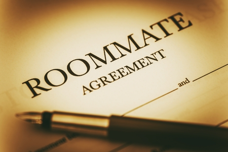 agreement: Roommate Agreement Signing. Sharing Living Space Legal Agreement. Stock Photo