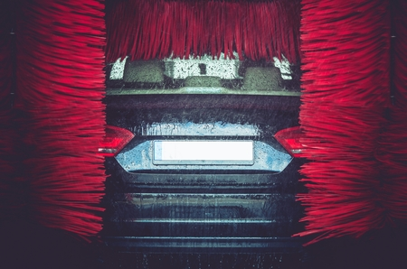 soaping: Automatic Brush Car Wash. Car Washing Closeup. Stock Photo