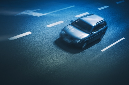 grading: Speeding Car on the Highway. Evening Blue Color Grading.