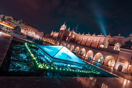 Magnificent Krakow at Night. Cracow Market Square During Late Night Hours, Poland, Europe. Medieval and Modern Architecture Combined.