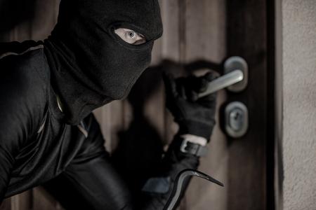 House Burglar in Mask Taking Action. Checking House Doors. House Burglary Concept.