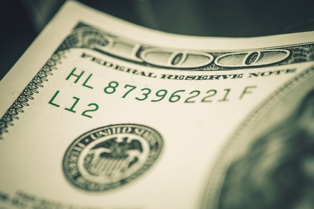 inprint: One Hundred American Dollars Banknote Serial Number. Currency Serial Number. Stock Photo