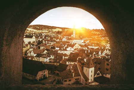 Cesky Krumlov Panorama Through The Castle Wall Window. Cesky Krumlov, Czechia, Europe. Sepia Color Grading.