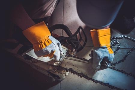 wood cutter: Replacing Wood Saw Chain Closeup Photo. Fixing Gasoline Chain Saw