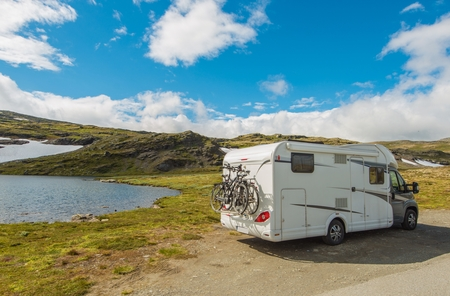 motorcoach: Wild Camping in a Camper Somewhere in the Mountains. Camper Van Traveling.
