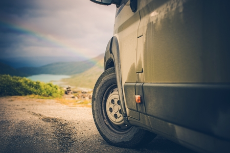 motorcoach: Camper and the Scenic Wild Landscape with Rainbow. Offroad Camper Driving.