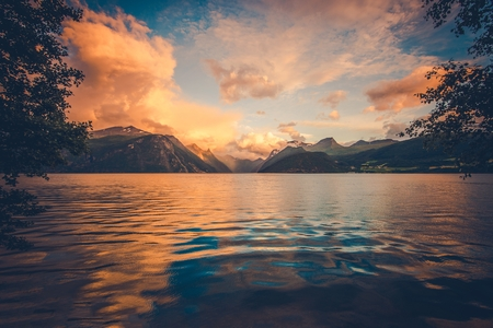 destination scenics: The Norwegian Fjord Sights. Scenic Scandinavian Fjords at Sunset. Norway, Europe.