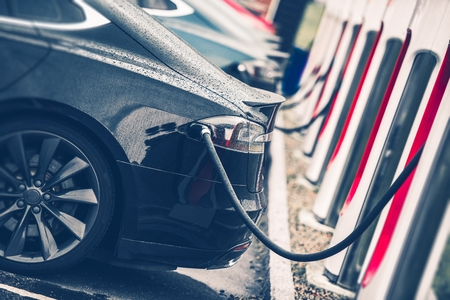 Electric Cars Charging Station Closeup Photo. Vehicle Rechargeable Batteries Charing. Future of Transportation. Reklamní fotografie - 62488324
