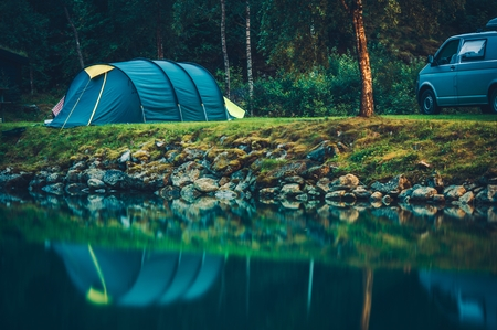 Camping on the Glaciar Lake. Tent Camping on the Campsite. Stock Photo