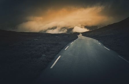 uncertain: Uncertain Road Ahead. Dark and Cloudy Mountain Road Journey. Rocky Norway Landscape.