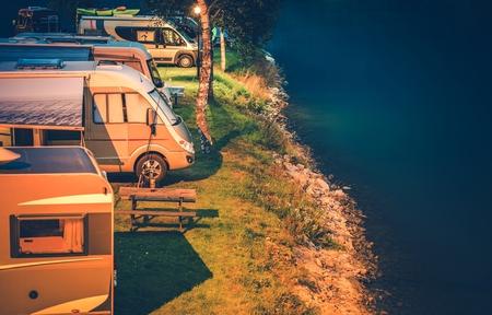RV Park and Camping at Night. Glacial Lake Shore Camper Camping.