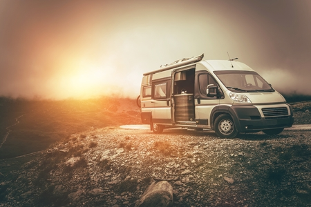 motorcoach: RV Camper Journey North. Scenic Mountain Landscape Camper Camping. Motorcoach Trip.