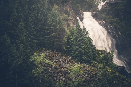 Mountain Waterfall Place. Scenic Mountain Landscape with Waterfall in the Norway. Stock fotó