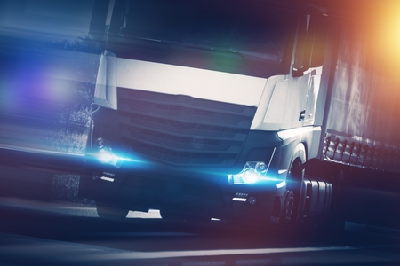 Speeding Modern Semi Truck Concept Photo. Euro Tracking and Spedition Theme.