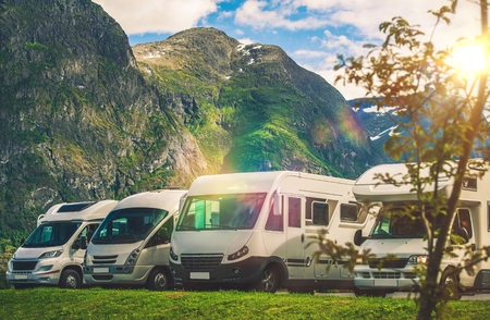 recreational: Scenic RV Park Camping. Few Camper Vans in Remote Location. RVing Theme. Stock Photo