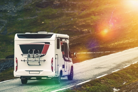 recreational vehicle: RV Camper Traveling. Recreational Vehicle on the Mountain Road. Wilderness Getaway.