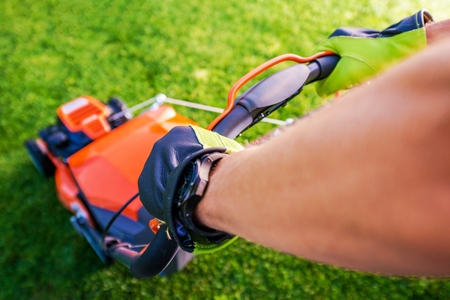 mowing grass: Grass Mowing Landscaping Theme. Lawn Mowing in Action. Stock Photo