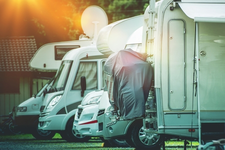 recreational: RV Camper Storage Place. Stored Recreational Vehicles on the Storage Parking Lot.