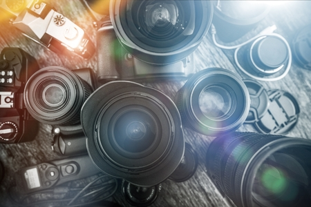 Photography Is My Passion. Professional Photography Equipment on the Table. Lenses, Cameras and Other Equipment For a Pro Photo Shooting.