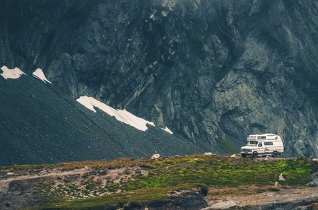 Camper Camping in the Wild Remote Mountain Landscape. Stock Photo