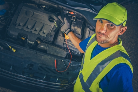 to proceed: Satisfied Car Mechanic with Broken Car. Mechanic Proceed with Car Maintenance. Auto Service Theme. Stock Photo