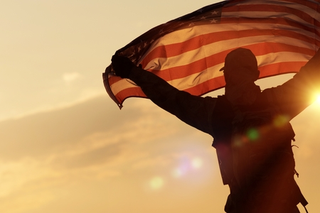 American Flag Celebration. Navy Soldier with United States of America Flag in Hands. Military Concept. Stock Photo