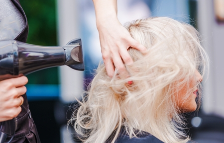 Hairdresser Business. Beauty Studio Hairstylist Air Blowing Clients Hair. Stock Photo