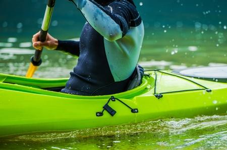 recreational sports: Recreational Lake Kayaking Closeup Photo. Kayak Paddling in Action. Water Sports Theme. Stock Photo