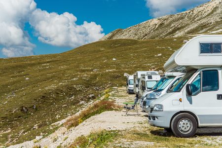 RV Motorhomes Camping in High Alpine Place. Scenic Campers Campground.