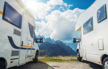 High Mountain Campers Camping. Two Motorhomes and the Scenic Mountain View. Outdoor and RVing Theme. Stock Photo